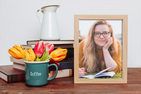 Photo Frame On Desk With Beautiful Flower